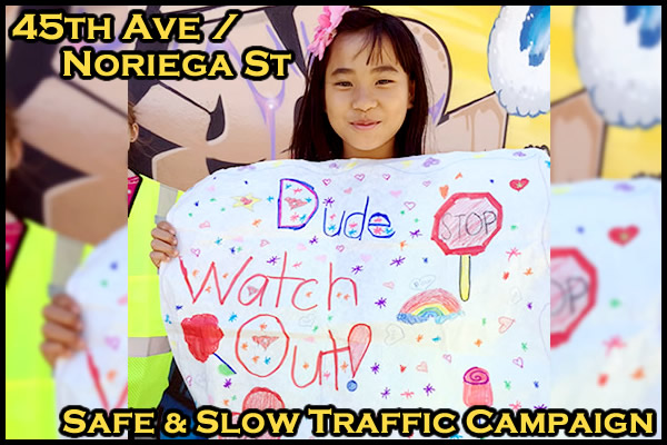 The Outer Noriega Merchants Association and kids from the Sunset Beacon Summer Program reminded drivers and pedestrians to stay alert at 45th Avenue and Noriega Street.