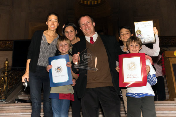John Zwolinski of La Playa poses with family after receiving, on behalf of the the La Playa Neighborhood Watch, the best Neighborhood Watch Group Award.